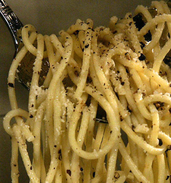 Spaghetti with crushed black pepper and pecorino cheese