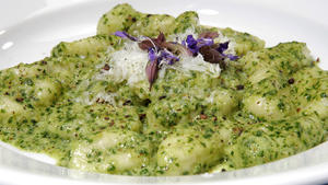 Sage gnocchi with parsley-walnut pesto