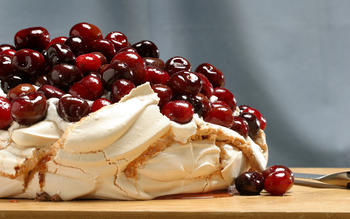 Roasted cherry Pavlova with cinnamon whipped cream