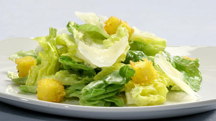 Butter lettuce with Parmigiano dressing and polenta croutons