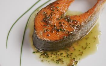 Pan-seared wild salmon steaks with chive vinaigrette