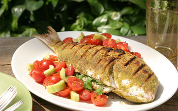 Grilled whole snapper with tomato-cucumber salad