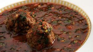 Kibbeh bi'kizabrath (cilantro-tomato soup with Syrian meatballs)
