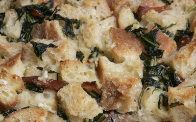 Bread pudding with dandelion greens and bacon
