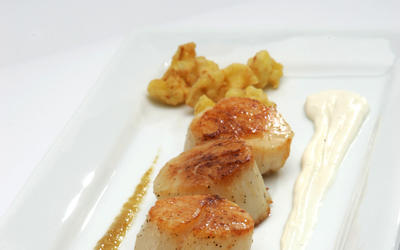 Cauliflower beignets with sea scallops and golden raisin puree