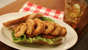 Fried shrimp sandwich with lettuce and tomato