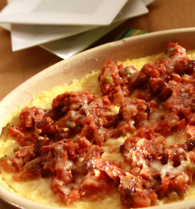 Polenta gratin with pancetta and tomato sauce