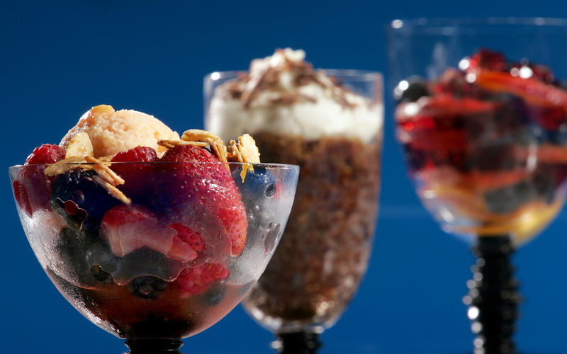 Berries jubilee with peach sorbet and salted candied almonds