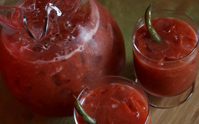 Bloody Marys garnished with pickled green beans