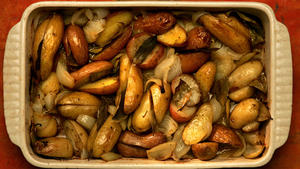 Roast potatoes, onions, fennel and bay leaves