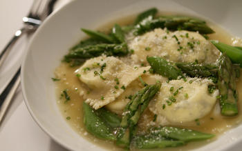 Spring vegetables in Parmesan broth with goat cheese ravioli