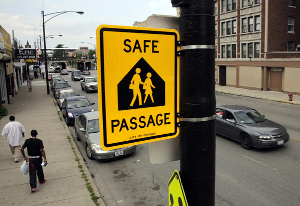 A Safe Passage sign is up on Central Avenue north of Fulton Street near Ellington Elementary on the West Side.
