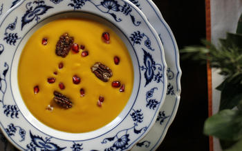 Kabocha squash soup with pomegranate seeds and spicy candied pecans