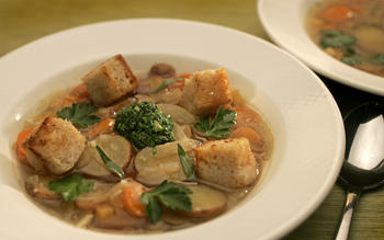 Rustic vegetable soup with rye croutons and parsley-savory 'pistou'