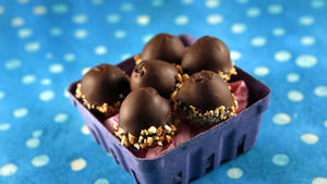 Chocolate-dipped almond eggs