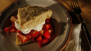 Orange-flavored shortcakes with strawberries and cream