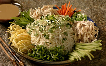Iced somen noodles with chicken and vegetables with spicy ginger sesame sauce
