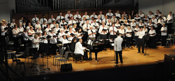 Chris Ludwa leads the Bay View Music Festival Choir during a recent performance in Hall auditorium. The music festival concludes the 2013 season with an evening concert on Sunday, Aug. 11.