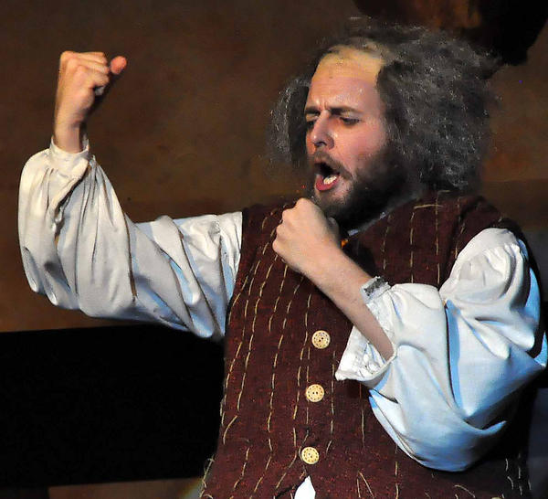 Falstaff, played by Isaac Droscha, shouts abuses at his servants for their disloyalty in this scene from the Falstaff opera.