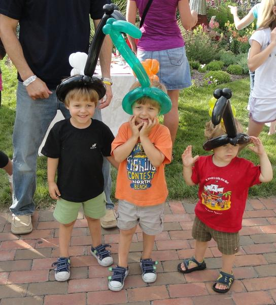 Kolten, Kaden and Kale Meir fashion their new hats from Twister Joe.