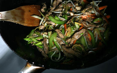 Peking duck stir-fried with ginger and green onion