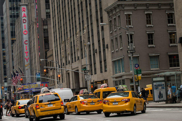 Taxis drive New York's Avenue of the Americas in June.