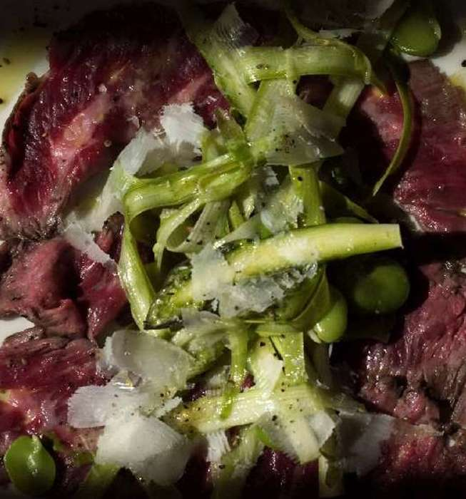 Skirt steak carpaccio with raw asparagus and fava salad