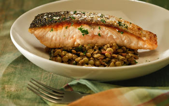 Crisp-skinned salmon with lentils, bacon and dandelion greens