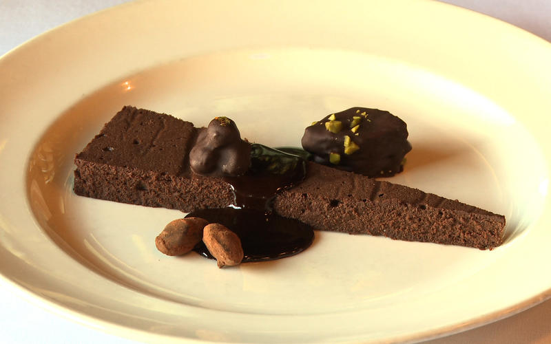 Bittersweet chocolate cake with hot fudge sauce and cioccolati perugini
