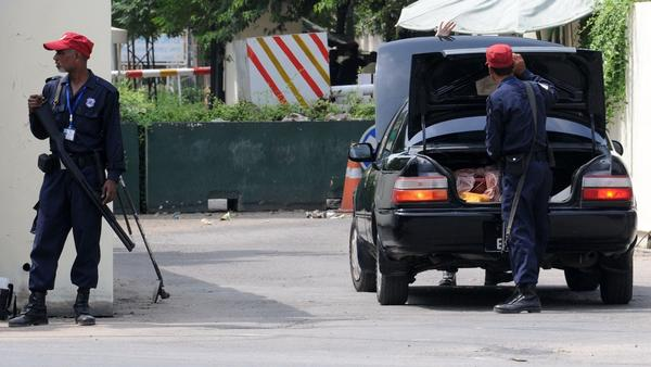 Security guards check a vehicle outside the U.S. consulate in Lahore, Pakistan.