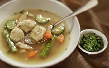 Sephardi chicken soup with herb-flecked kneidelach