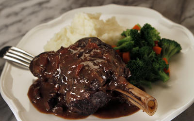 Amtrak's braised lamb shanks with portobello mushroom, tomatoes and oregano