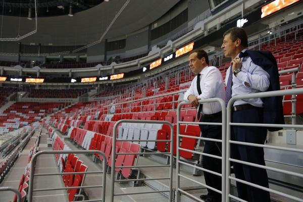 Russian Prime Minister Dmitry Medvedev, left, and Deputy Prime Minister Dmitry Kozak take in the view from the stands of the Bolshoy Ice Dome, a venue for the 2014 Winter Olympics, during a visit to Sochi.