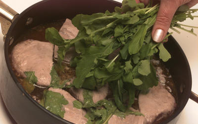 Ahi tuna steeped in red wine with wilted arugula