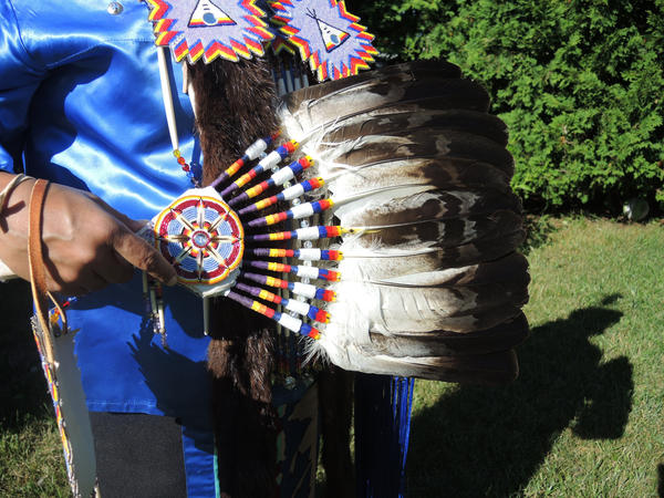 Eagle feathers are given to an individual as a symbol of maturity. Many dancers incorporate the feathers into fans.