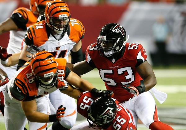 The Falcons' Brian Banks (53) runs the defense against the Bengals in the fourth quarter at Georgia Dome.