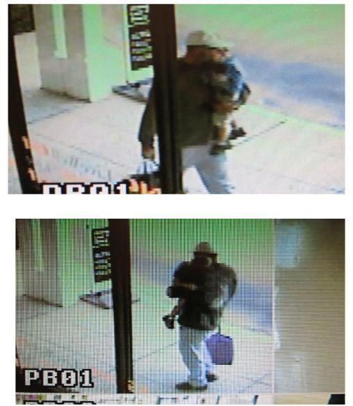 Police released security images Friday of a man holding a child who used a restroom for a diaper change before electronics were stolen from an adjacent storage room at an AT&T store in Daytona Beach.