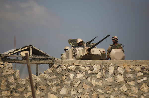 Egyptian soldiers stand guard at the northern Sinai border with the Gaza Strip on July 5.