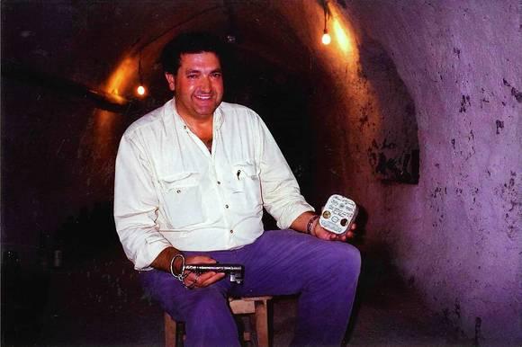 Ambrosio Molinos de las Heras holds a tin of Paramo de Guzman