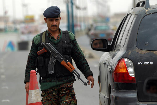 A Yemeni soldier checks vehicles near Sanaa International Airport.