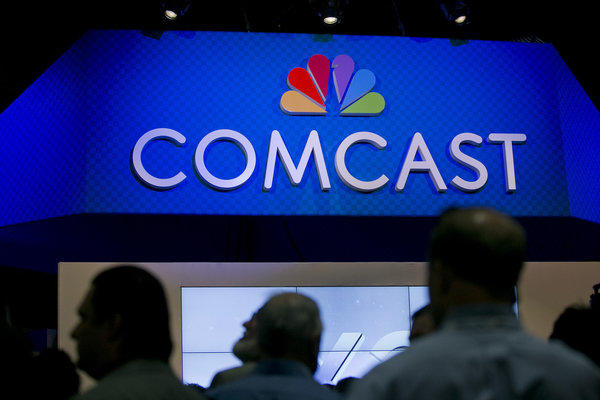 The Comcast Corp. logo is seen on the exhibit floor at the National Cable and Telecommunications Association Cable Show in Washington, D.C., in June.