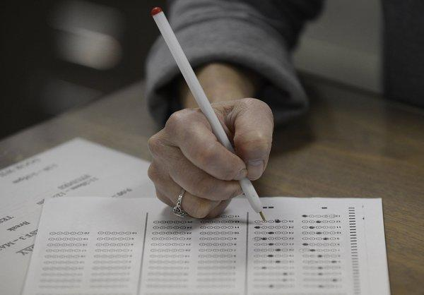 Officials say students from 16 California schools posted standardized test-related images on social-networking sites that could be deemed cheating violations.