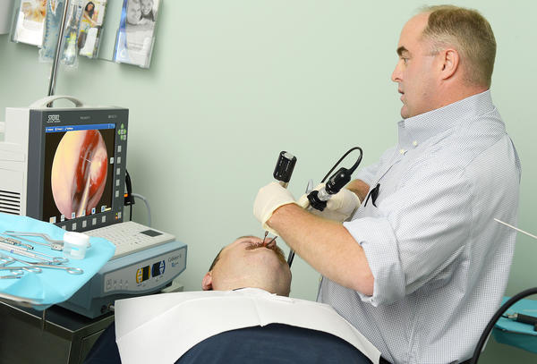 Dr. Kirby Scott performs a minimally invasive in-office sinus surgery on David Caldwell of Falling Waters, W.Va., at Central ENT Consultants PC, off the Dual Highway in Hagerstown.