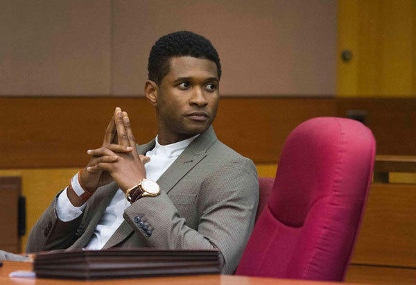 R&B singer Usher waits for court to begin during a custody hearing at Fulton County Courthouse in Atlanta, Georgia.
