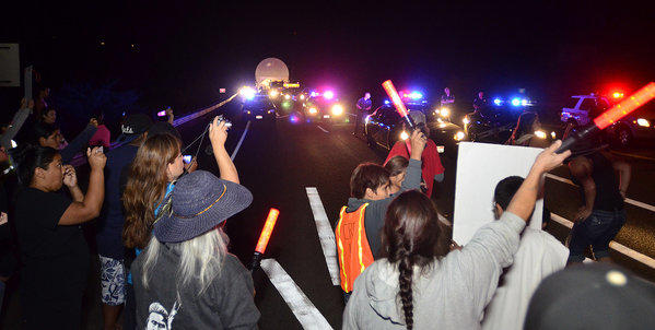 Members of the Nez Perce tribe and other protestors attempt to halt a megaload shipment carrying equipment to the Canada tar sands on Tuesday.