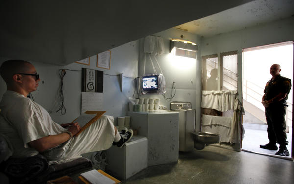 A guard watches inmate Javier Zubiate in the isolation unit at Pelican Bay State Prison in Crescent City, Calif.