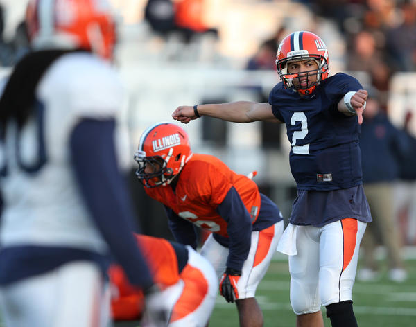Illinois quarterback Nathan Scheelhaase directs the offense during a team practice at Gately Stadium.