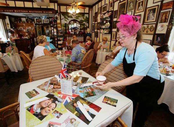 Marsha Goodale sets a table onTuesday, August 6, 2013. The Windsor Rose Tea Room in Mount Dora hosted a royal baby shower for Prince George of Cambridge, son of Prince William and Kate Middleton.