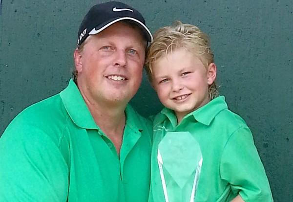 From left, Kirk Johnson and his son, Kylan, 6.