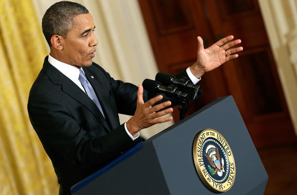 President Barack Obama answers questions during a news conference in the East Room of the White House on Friday.